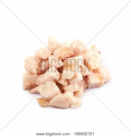 Pile of bacon fat cube bits isolated over the white background