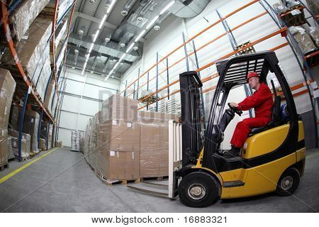 forklift  truck reloading pallets in storehouse