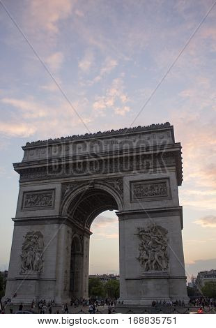 Sun starting to set at the Arc de Triomphe