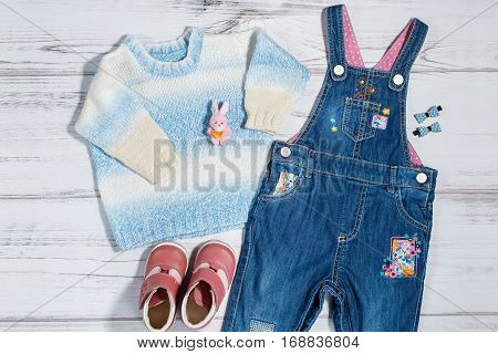 Baby girl clothes collection - denim overalls, knitted sweater, leather boots, hair bows