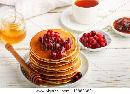 Pancake With Honey And Fresh Berries. Cranberry, Cowberry. Gourmet Breakfast. Selective Focus