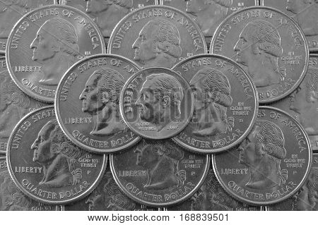 Coins of USA. Pile of the US quarter coins with George Washington