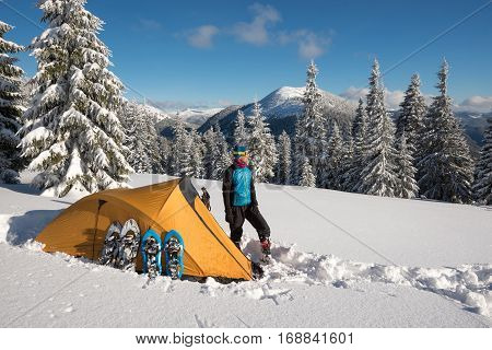 Man, Traveler Relax Near A Tent And Equipment In The Mountains