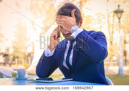 Man in suit having problematic news