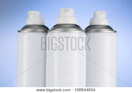 Aerosol spray cans nozzle closeup. Spray cans with shallow depth of field. Air freshener product studio photograph