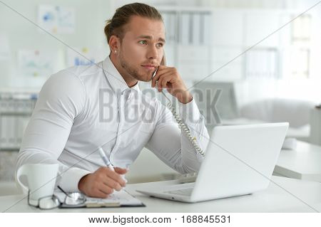 young handsome office worker, in formal clothes