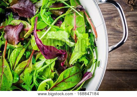 Fresh Salad With Mixed Greens On Wooden Background Closeup