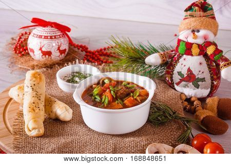 Goulash Soup With Cheese Sticks And Decor