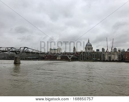 LONDON - JANUARY 12: Facing North over The River Thames towards the Millennium Bridge and St. Paul's Cathedral on January 12, 2017 in Southwark, London, UK.