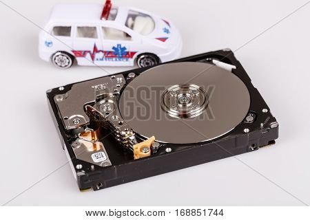 ambulance car on harddrive or hdd - data backup safe and rescue concept
