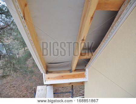 Install Soffit. Roofing Construction. Soffit and Fascia is Usually Constructed of Vinyl Wood or Aluminum and is Installed on the Underside of Roof Overhangs and Eaves.