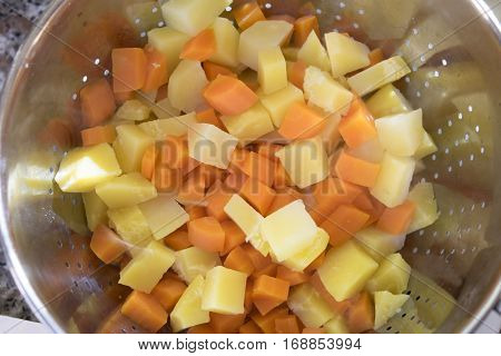 potatoes and carrats cut in cubes and cooked in pressure cooker