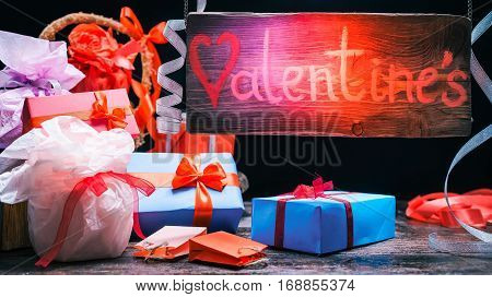 Valentines gift shop. Giftboxes variety. Wood sign in swirling beam of red and blue color changing light. Concept for animated valentine banner