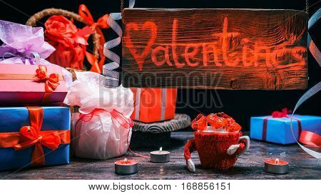 Red-lighted sign of valentine gift shop. Assortment of giftboxes. Candy hearts. Concept for animated sign of gift store