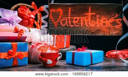 Red-lighted wood sign of valentine gift shop. Assortment of giftboxes. Concept for animated sign of gift store