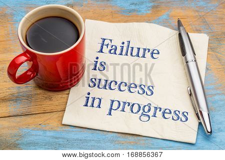 Failure is success in progress - handwriting on a napkin with a cup of coffee