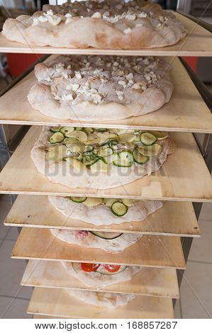 Various cooked romana pizza on a rack