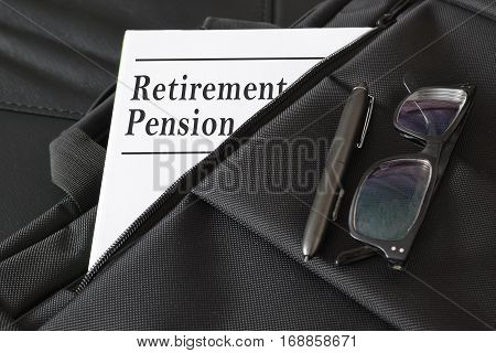 Briefcase containing some retirement pension documents and reports. Empty copy space for editor's text.