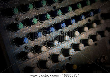 Part of audio sound mixer with buttons antique texture background.