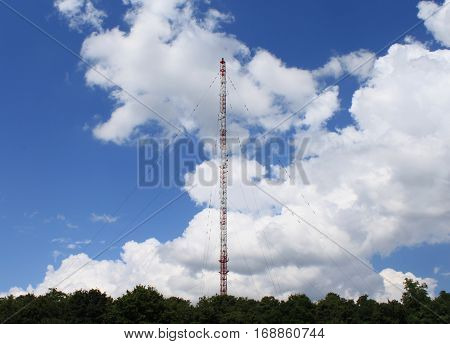 Regional radio transmitter antenna tower over blue sky