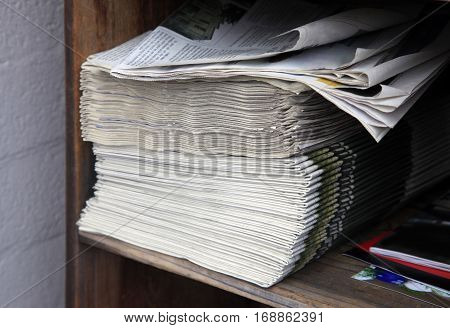 Big pile of newspapers close up .