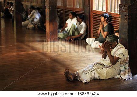 Kandy Sri Lanka - April 03 2011: People pray in Buddhist church. Kandy Sri Lanka