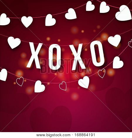 White hanging text XOXO with Hearts on shiny background, Elegant greeting card design for Happy Valentine's Day celebration.