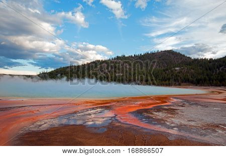 Grand Prismatic Hot Spring under sunset clouds in the Midway Geyser Basin in Yellowstone National Park in Wyoming U S A