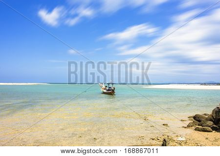 Fishing Boat On The Seascape And Cloud Moving In Blue Sky At Asia Beach