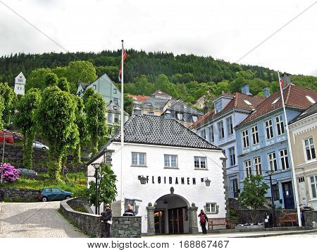 Bergen, Norway - June 8, 2009: People waiting outside the lower station of the Floibanen in Bergen, Norway. The Floibane is a funicular to the 320 meter high Mount Floyen.
