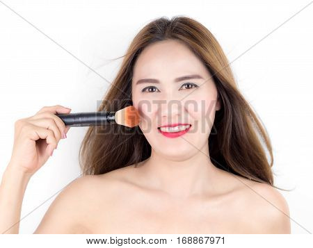 Asian Beautiful Woman Applying Cosmetic Powder Brush On Smooth Face Isolated On White Background. Sk