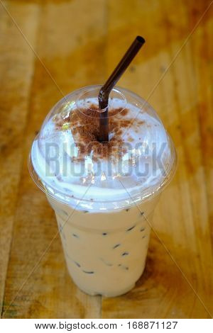 Iced coffee mocca with straw in plastic cup