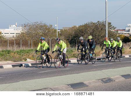 Nahariyya Israel - February 04 2017 : Group of cyclists on a winter morning trains on intercity road near Nahariyya Israel