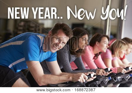 New Year New You! Man exercise at spinning class at a gym