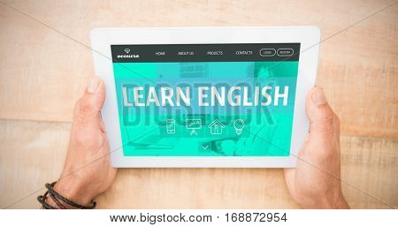 Learn english interface against hands holding blank screen tablet