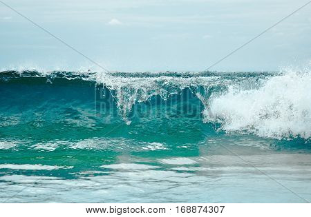 Close up photography of colorful sea wave with sunny blue sky on horizon in Phuket, Thailand. Outdoor landscape of big ocean waves in Southeast Asia.