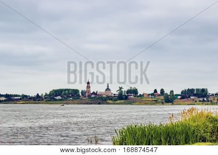 Russian Sredneivkino village on the lake in a cloudy day