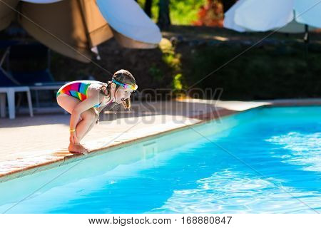 Little Girl Jumping Into Swimming Pool