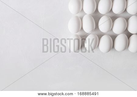 White eggs in the form of a square on a white background. Easter Concept Photo
