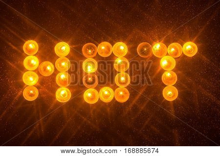 hot words written in candels with star filter effect