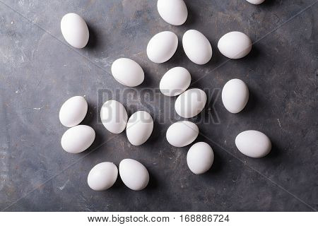 White eggs on a gray background. Eggs. Easter photo concept. Copyspace