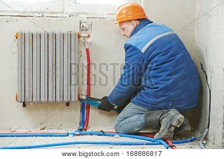 engineer repairmen installing heating system