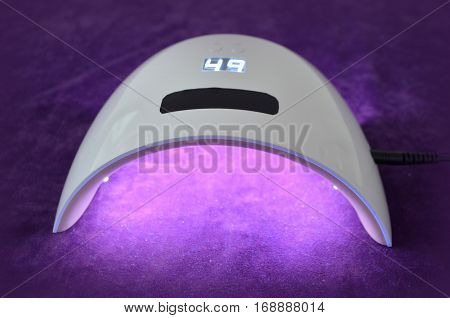 Nail gel salon. Lamp UV  for nails UV with timer