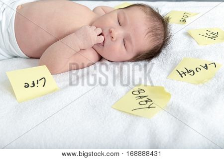 Innocent Baby With Thoughts Written On Sticky Notes All Around