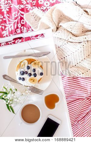 concept of breakfast in bed on tray with juice top view