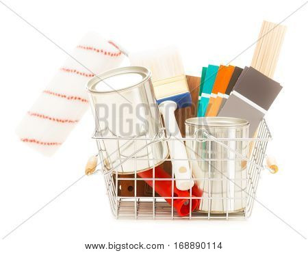shopping basket with wall paint, paint brushes, color swatches and other stuff neessary for redesigning your home