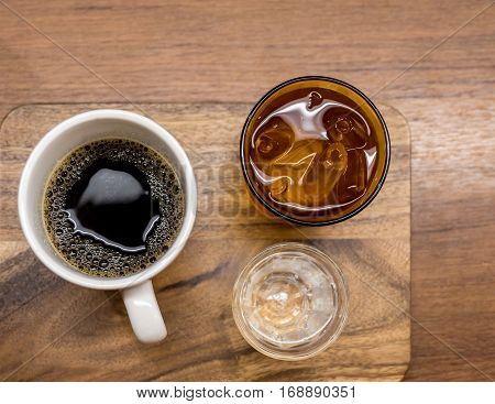 drip coffee serve with ice water and soda shot on wooden plate