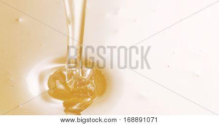 honey drips from wooden dipper, 4k closeup photo