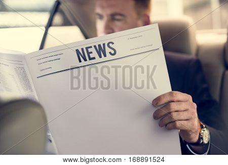 Businessman Reading Newspaper Car Inside