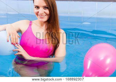 Woman Having Fun With Balloons In Water Pool